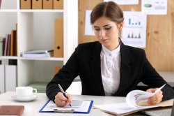 bigstock-businesswoman-sit-at-126953924copy
