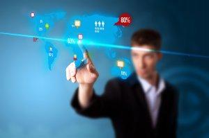 bigstock_Businessman_pressing_social_me_25559501