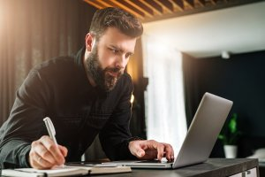 bigstock_Young_Bearded_Businessman_Is_S_258704827